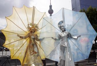 stilt walkers - sun & moon